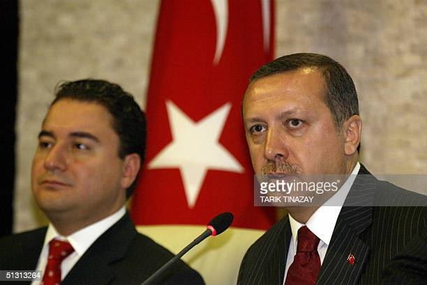 Turkish Prime Minister Recep Tayyip Erdogan and Economy Minister Ali Babacan are pictured during a press conference about Turkey's economy and new...