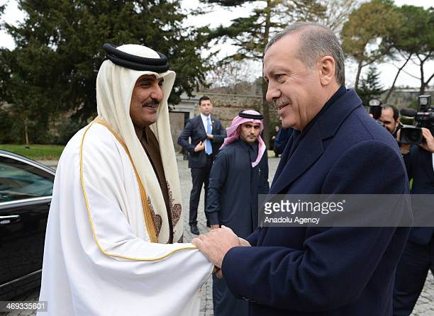Turkish Prime Minister Recep Tayyip Erdogan and Emir of the State of Qatar Sheikh Tamim bin Hamad Al Thani shake hands following the meeting at the...