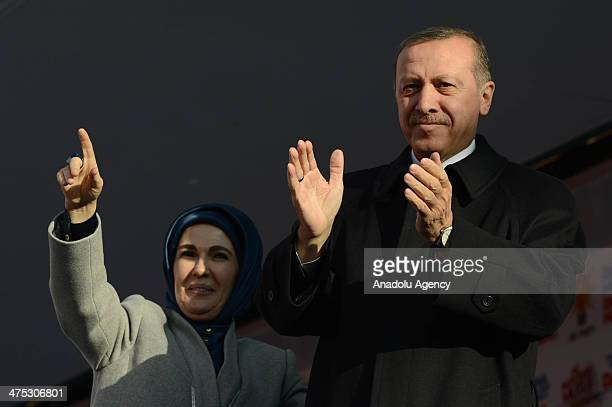 Turkish Prime Minister Recep Tayyip Erdogan and his wife Emine Erdogan greet public during a local election rally organized by the ruling Justice and...