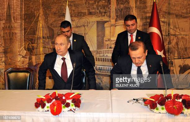 Turkish Prime Minister Recep Tayyip Erdogan and Russian President Vladimir Putin arrive for a press conference in Istanbul on December 3 2012 he...