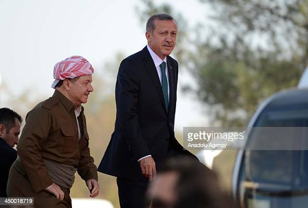 Turkish Prime Minister Recep Tayyip Erdogan and The head of autonomous Kurdish government in Iraq's north Masoud Barzani attend a mass opening...
