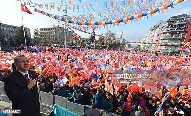Turkish Prime Minister Recep Tayyip Erdogan greets public during a local election rally organized by the ruling Justice and Development Party in Usak...