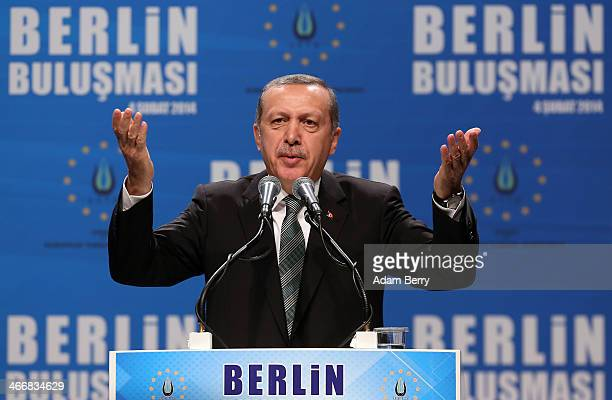 Turkish Prime Minister Recep Tayyip Erdogan greets supporters at a rally at Tempodrom hall on February 4 2014 in Berlin Germany Turkey will soon face...