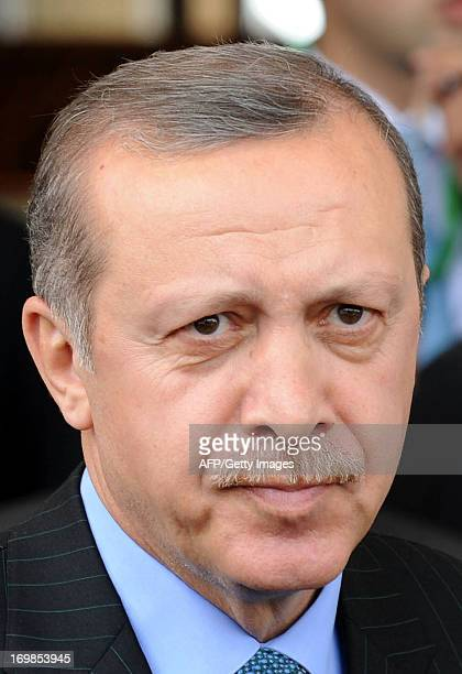 Turkish Prime Minister Recep Tayyip Erdogan looks on following a welcome ceremony at Rabat airport on June 3 2013 at the start of a tour of the...