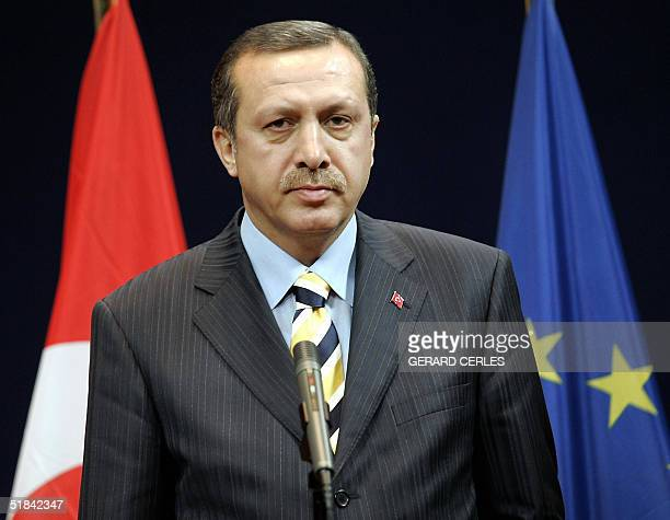 Turkish prime minister Recep Tayyip Erdogan poses for photographers prior to a bilateral meeting with Dutch prime minister, current chairman of the...
