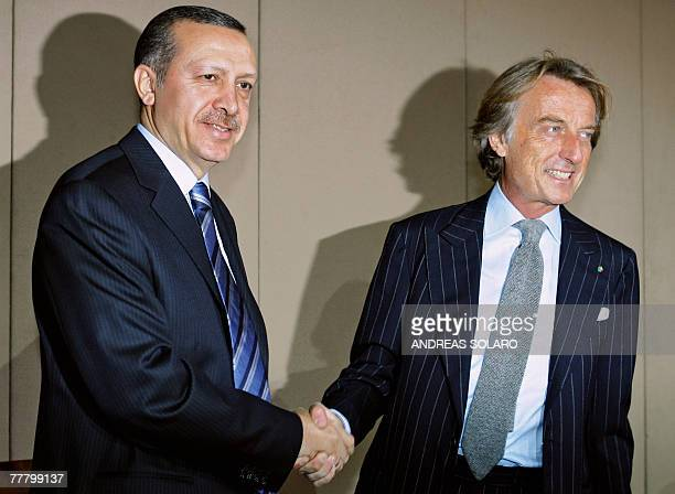 Turkish Prime Minister Recep Tayyip Erdogan shakes hands with FIAT chairman and president of the Confederazione Generale dell'Industria Italiana Luca...