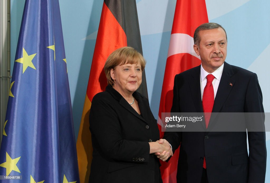 Turkish Prime Minister Recep Tayyip Erdogan (R) shakes hands with German Chancellor Angela Merkel after a news conference in the German federal chancellery on October 31, 2012 in Berlin, Germany. The two leaders discussed the conflict in Syria, relations between Germany and Turkey, and the latter's aspirations to join the European Union. Erdogan had attended the opening of a new Turkish embassy in the city the night before, where he stressed the importance of Turkish integration into the country, particularly when it comes to learning the local language. German Turks form the largest ethnic minority in the country.