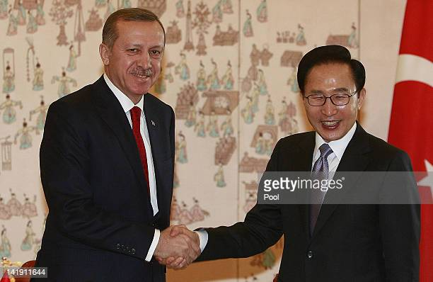 Turkish Prime Minister Recep Tayyip Erdogan shakes hands with South Korean President Lee Myung bak before their meeting at the Presidential house on...
