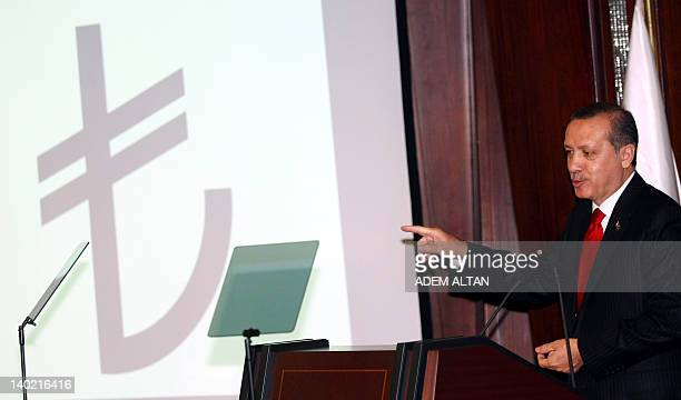 Turkish Prime Minister Recep Tayyip Erdogan speaks during a ceremony to introduce the new symbol for the national currency the Turkish lira in Ankara...