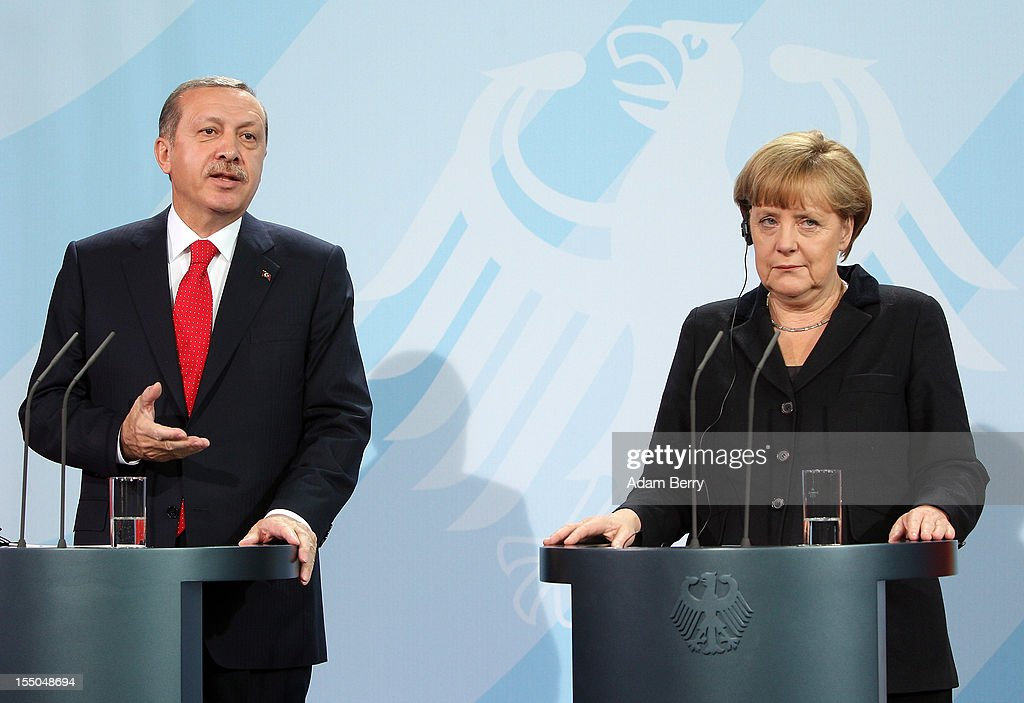 Turkish Prime Minister Recep Tayyip Erdogan (L) speaks during a news conference with German Chancellor Angela Merkel in the German federal chancellery on October 31, 2012 in Berlin, Germany. The two leaders discussed the conflict in Syria, relations between Germany and Turkey, and the latter's aspirations to join the European Union. Erdogan had attended the opening of a new Turkish embassy in the city the night before, where he stressed the importance of Turkish integration into the country, particularly when it comes to learning the local language. German Turks form the largest ethnic minority in the country.