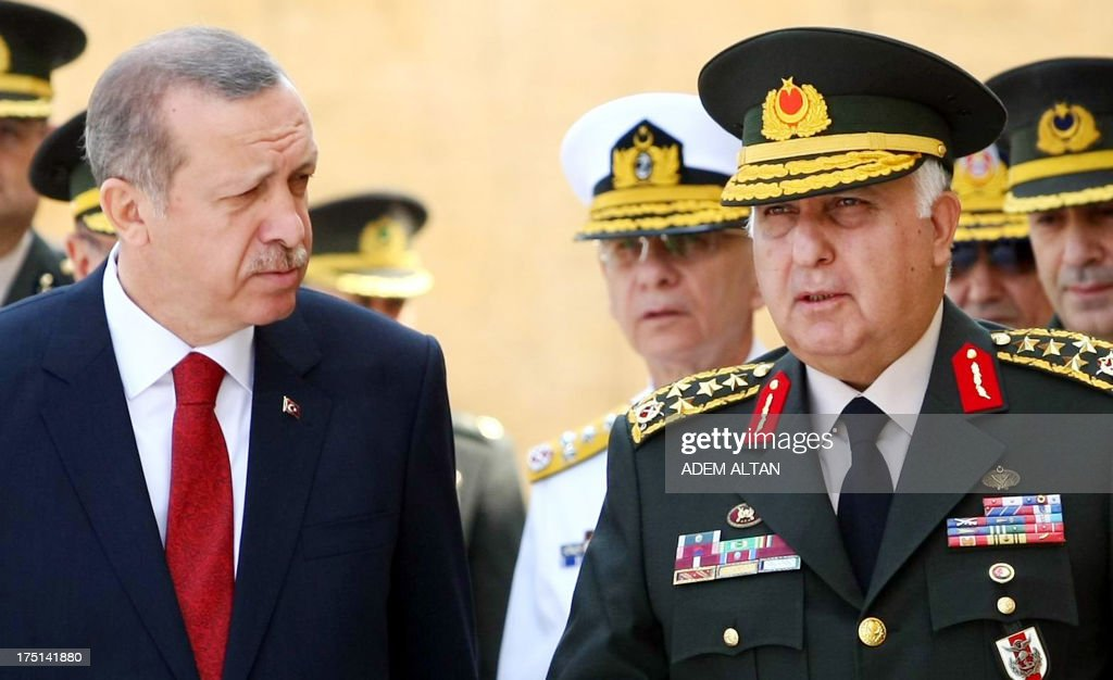 Turkish Prime Minister Recep Tayyip Erdogan (L) speaks to Chief of Staff General Necdet Ozel at the mausoleum of modern Turkey's founder Mustafa Kemal Ataturk before a meeting of the High Military Council in Ankara on August 1, 2013.