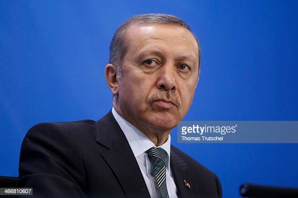 Turkish Prime Minister Recep Tayyip Erdogan speaks to the media following talks with German Chancellor Angela Merkel at the Chancellery on February...