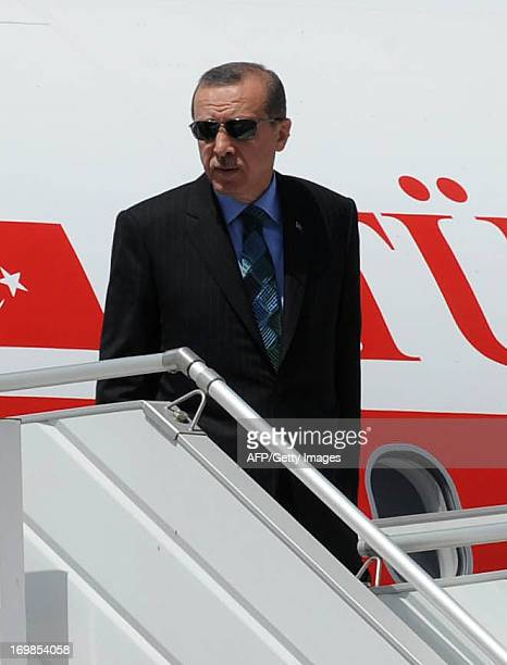 Turkish Prime Minister Recep Tayyip Erdogan steps out from his airplane as he arrives at Rabat airport on June 3 2013 at the start of a tour of the...