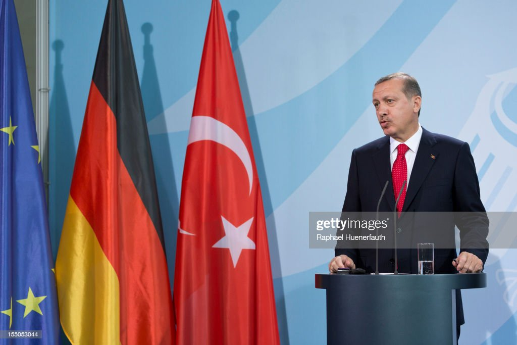 Turkish Prime Minister Recep Tayyip Erdogan talks during a joint press conference with German Chancellor Angela Merkel on October 31, 2012 in Berlin, Germany. The two leaders held talks on bilateral relations, the crisis in Syria and Turkey's bid to join the European Union. Erdogan also attended the opening of a new Turkish embassy after his arrival on Tuesday.