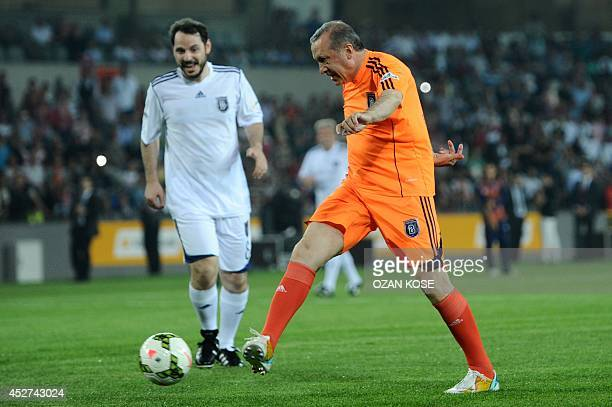 Turkish Prime Minister Recep Tayyip Erdogan vies for the ball with Beraat Albayrak during an exhibition match at the Basaksehir stadium on 26 July,...