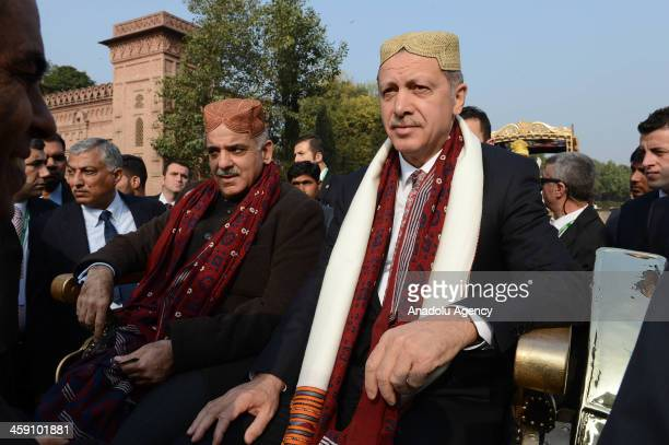 Turkish Prime Minister Recep Tayyip Erdogan visits the Grand Cultural Show as he wears a traditional cap that was given as a present by the Chief...