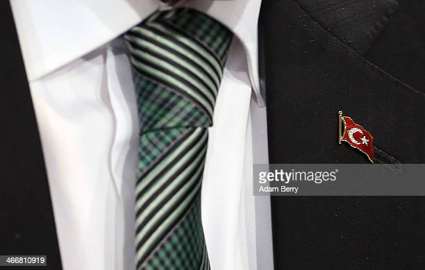 Turkish Prime Minister Recep Tayyip Erdogan wears a lapel pin of the Turkish flag as he speaks to the media following talks with German Chancellor...