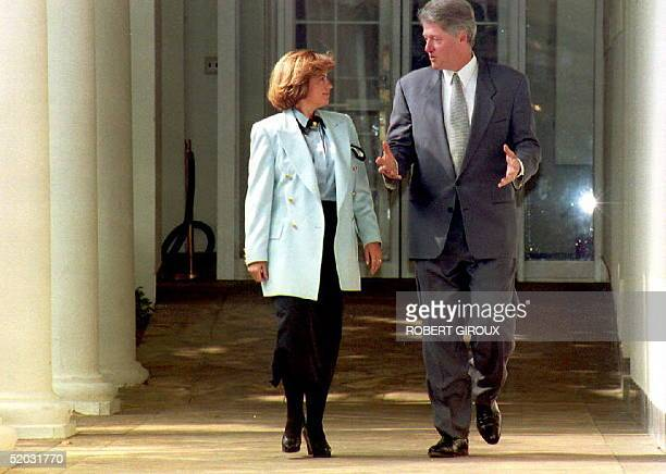 Turkish Prime Minister Tansu Ciller walks 15 October 1993 with U.S. President Bill Clinton from the Oval office at the White House in Washington, DC....