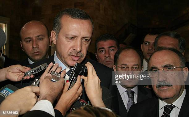 Turkish Prime Minister Tayyip Erdogan speaks to the media with his Interior Minister Besir Atalay in Ankara on July 1 2008 Turkey's Constitutional...