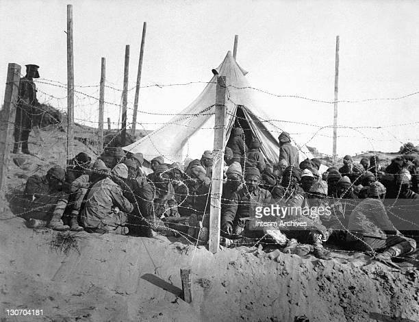Turkish prisoners are gathered behind barbed wire fencing at Seddul Bahr during the Dardanelles campaign 1915