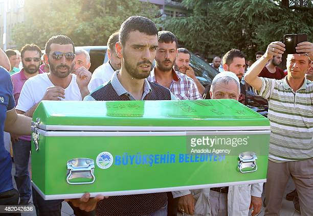 Turkish professional motorcycle racer Kenan Sofuoglu holds coffin of his fourmonthold baby Hamza Sofuoglu who suffered brain hemorrhage several...