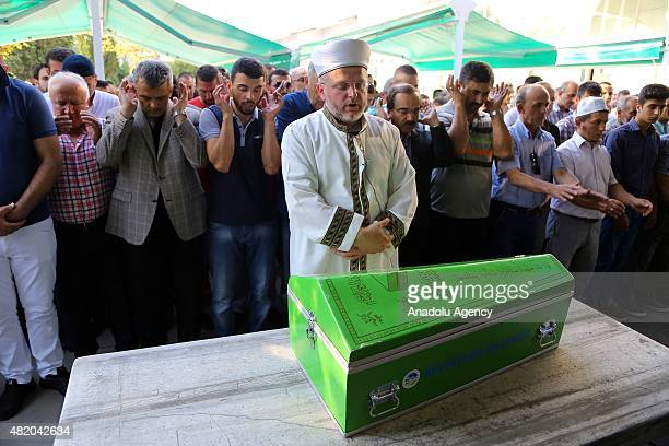 Turkish professional motorcycle racer Kenan Sofuoglu performs funeral prayer of his fourmonthold baby Hamza Sofuoglu who suffered brain hemorrhage...