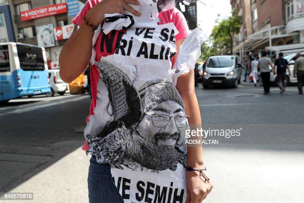 A Turkish protester holds a poster during a demonstration against the detention of hungerstriking teacher Semih Ozakca and hungerstriking literature...