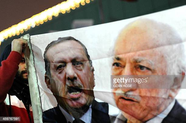 A Turkish protester holds up a banner with pictures of Turkish Prime Minister Recep Tayyip Erdogan and the United Statesbased Turkish cleric...