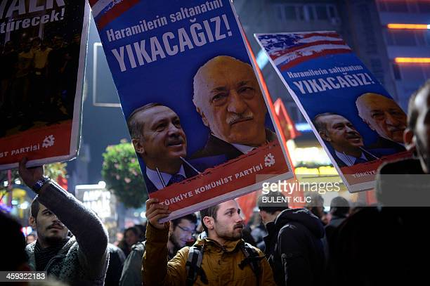 A Turkish protester holds up a placard with pictures of Turkish Prime Minister Recep Tayyip Erdogan and the United Statesbased Turkish cleric...