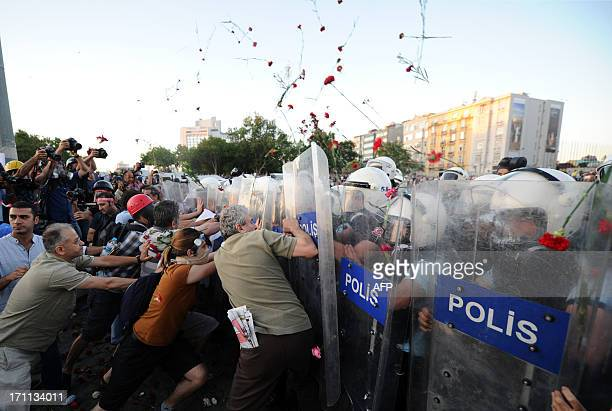 Turkish protesters clash with Turkish riot policemen on Taksim square in Istanbul on June 22 2013 Turkish police used water cannon today to disperse...