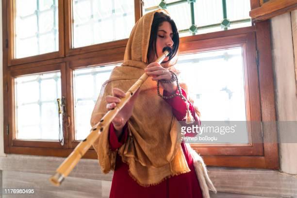 turkish reed flute artist. sufi muslim woman in mosque - arte, cultura e espetáculo imagens e fotografias de stock