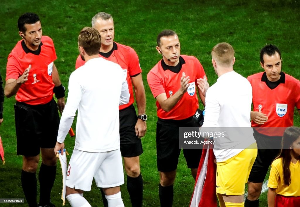 Croatia v england semi final 2018 fifa world cup pictures turkish referee cuneyt cakir right 3 and assisting referees greeting players before the 2018 m4hsunfo
