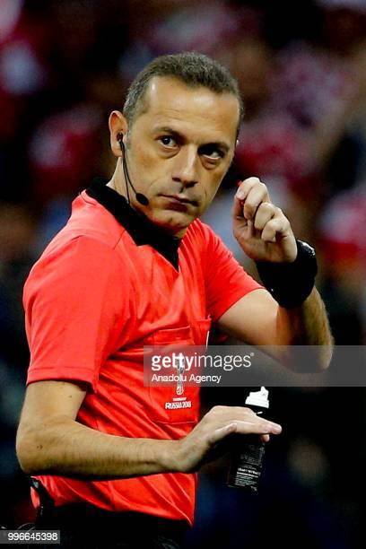 Turkish referee Cuneyt Cakir gestures during the 2018 FIFA World Cup Russia semi final match between Croatia and England at the Luzhniki Stadium in...