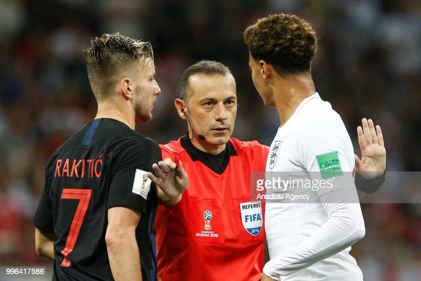 Turkish referee Cuneyt Cakir interferes the argument between Dele Alli of England and Ivan Rakitic of Croatia during the 2018 FIFA World Cup Russia...