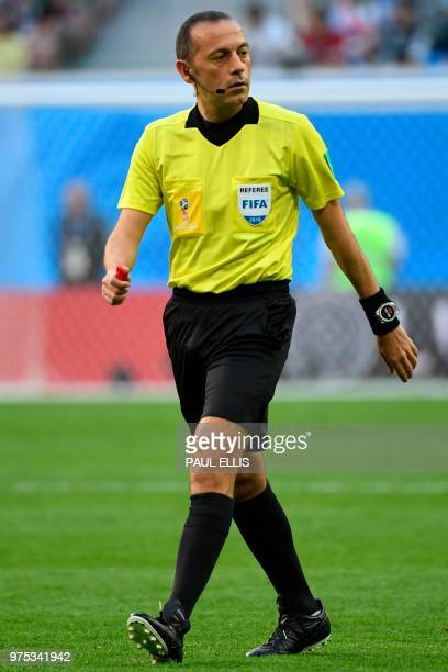 Turkish referee Cuneyt Cakir walks during the Russia 2018 World Cup Group B football match between Morocco and Iran at the Saint Petersburg Stadium...