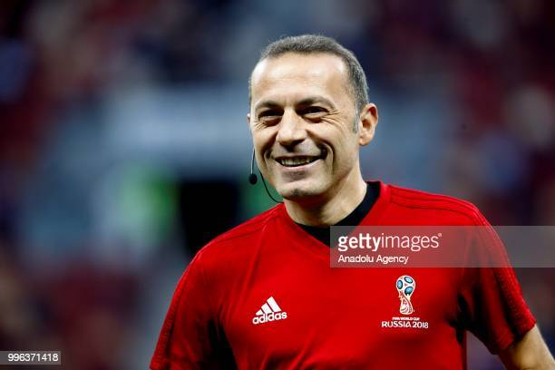 Turkish referee Cuneyt Cakr is seen before the 2018 FIFA World Cup Russia semi final match between Croatia and England at the Luzhniki Stadium in...