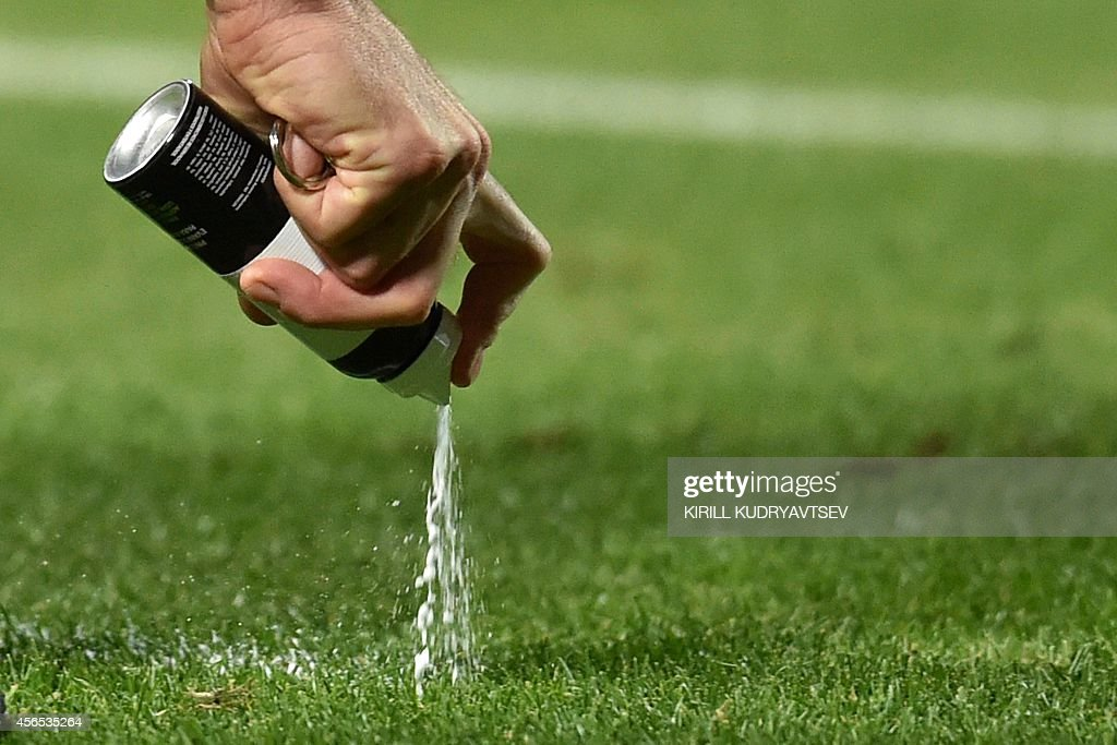 Turkish referee Huseyin Gocek uses a vanishing spray to mark out a free-kick during the UEFA Europe League group H football match between Krasnodar and Everton in Krasnodar on October 2, 2014.