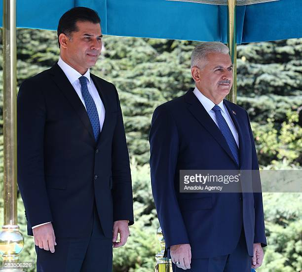 Turkish Republic of Northern Cyprus Prime Minister Huseyin Ozgurgun is welcomed by Prime Minister of Turkey Binali Yildirim during an official...