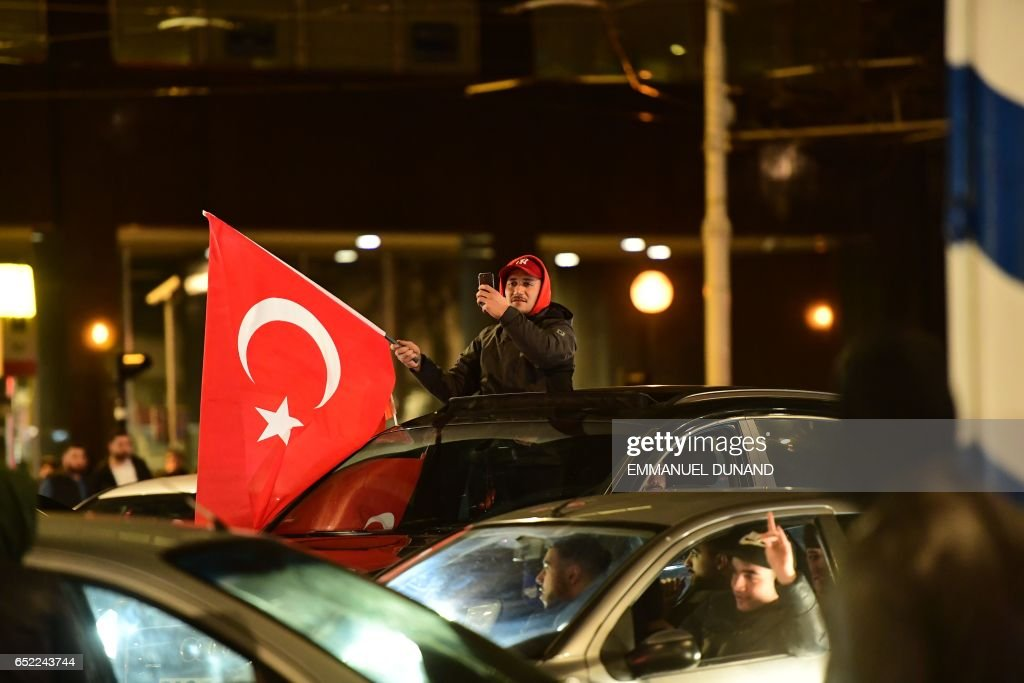 Turkish residents of the Netherlands gather for a protest in Rotterdam on March 11, 2017. Protests erupted in the Dutch port city of Rotterdam late on March 11 outside the Turkish consulate amid a row with Ankara after Dutch authorities banned the visits of Turkish ministers. About 1,000 people waving Turkish flags gathered on the street leading to the consulate, as tensions rocketed over rallies abroad to help Ankara gain backing for an April referendum vote. PHOTO / Emmanuel DUNAND