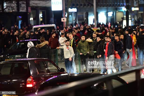 Turkish residents of the Netherlands gather for a protest outside Turkey's consulate in Rotterdam on March 11 2017 Protests erupted in the Dutch port...