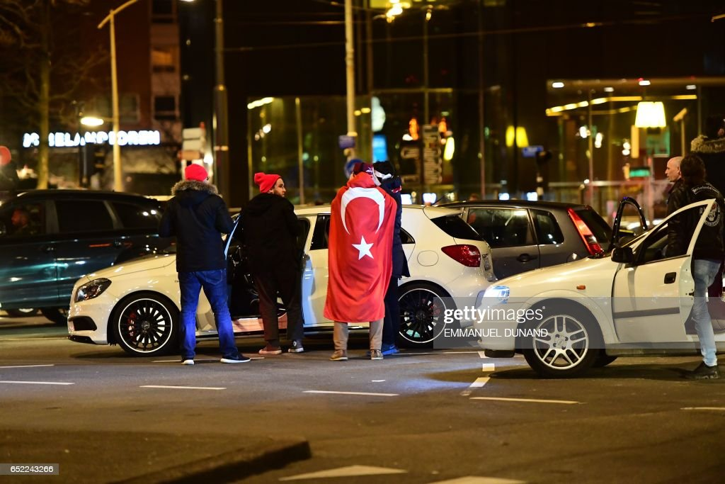 Turkish residents of the Netherlands gather for a protest outside Turkey's consulate in Rotterdam on March 11, 2017. Protests erupted in the Dutch port city of Rotterdam late on March 11 outside the Turkish consulate amid a row with Ankara after Dutch authorities banned the visits of Turkish ministers. About 1,000 people waving Turkish flags gathered on the street leading to the consulate, as tensions rocketed over rallies abroad to help Ankara gain backing for an April referendum vote. PHOTO / Emmanuel DUNAND
