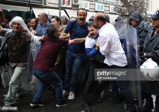 Turkish riot police attempt to disperse protesters during a demonstration against the arrest of hunger strikers Nuriye Gulmen and Semih Ozakca in...