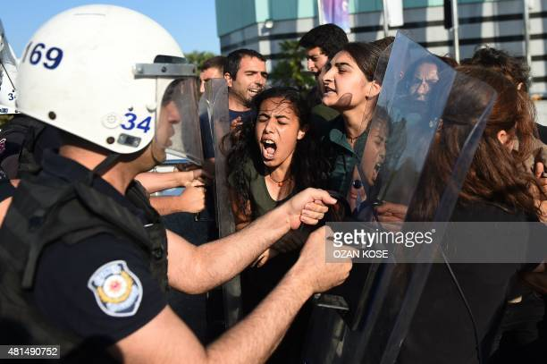 Turkish riot police clash with protesters as they attempt to detain them in Istanbul on July 21 a day after a suicide bomb attack the day before...