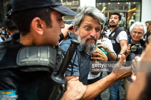 Turkish riot police detain a protester of Saturday mothers group demonstration on August 25 2018 in Istanbul Istanbul police break up a regular...
