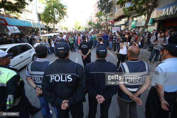 Turkish riot police form a barricade infront of the relatives of the trapped miners during a protest in Soma, a district in Turkey's western province...