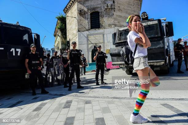 TOPSHOT Turkish riot police officers block ways to Istikjlal avenue for LGBT rights activist as they try to gather for a pride parade which was...