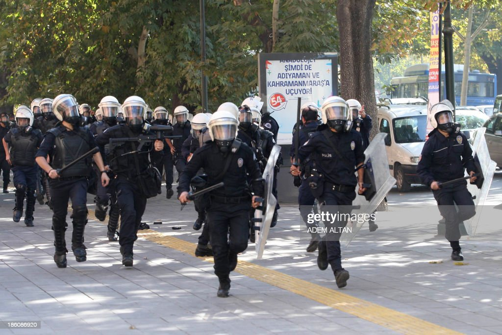 Turkish riot police run to disperse a demonstration in Ankara on October 28, 2013 against a court's refusal to detain a policeman accused of killing a demonstrator during the popular unrest in June. A police officer identified only as Ahmet S. is on trial accused of shooting to death 26-year-old Ethem Sarisuluk during mass anti-government street protests in Ankara in June. The Ankara court rejected a demand by the victim's lawyers that the defendant be detained and ruled instead that he could take part in hearings via video conference for security reasons.