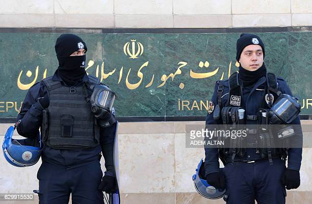 Turkish riot police stand guard in front of the Iranian Embassy during a protest against Iran's role in Aleppo in Ankara on December 15 2016 / AFP /...