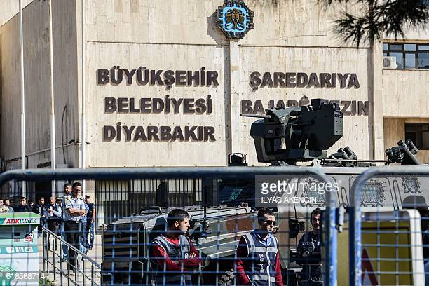 Turkish riot police stand guard outside the Diyarbakir municipality building following the arrest of the two comayors on October 27 2016 The two...