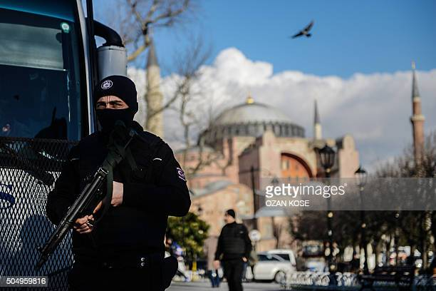 A Turkish riot police stands guard on January 14 2016 on the site of the January 12 attacks at the Istanbul's tourist hub of Sultanahmet Turkey said...